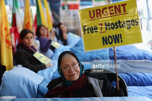 Women take part in a hunger strike outside the US embassy in protest over violence in Iraq on November 19 2013 in London England The demonstrators...