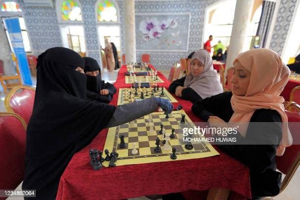 Women take part in a local Chess championship in Yemen's capital Sanaa on August 25, 2021.