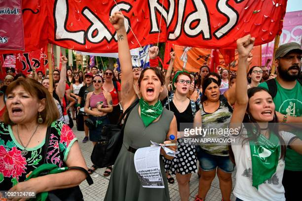 Women take part in a march called by the 'Ni una menos' movement against gender violence in Buenos Aires on February 1 2019 So far in 2019 22...