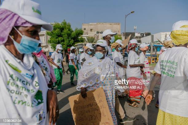 Women take part in a march for the environment in Dakar on October 23 one week before the COP26 global climate summit.