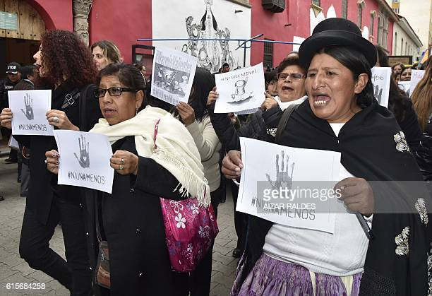 Women take part in a march in La Paz on October 19 to protest against violence against women and in solidarity for the brutal killing of a 16yearold...