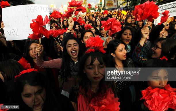 Women take part in a march in Santiago on October 19 to protest against violence against women and in solidarity for the brutal killing of a...