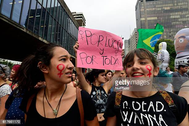 Women take part in a march in Sao Paulo on October 23 to protest against violence against women and in solidarity for the brutal killing of a...
