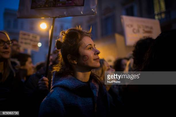 Women take part in a march organised by 'Non Una Di Meno' movement on March 8 2018 as part of the International Women's Day in Rome on march 8 2018