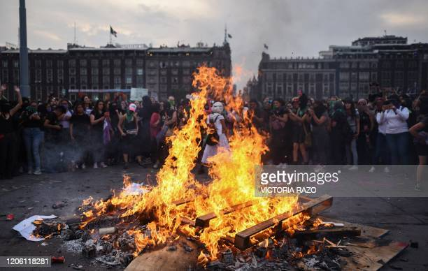 Women take part in a protest during the International Women's Day in Mexico City on March 8 2020 Women around the globe are taking action to mark...