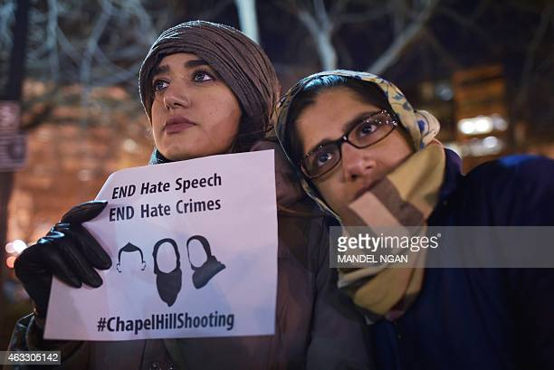 Women take part in a vigil for three young Muslims killed in Chapel Hill North Carolina at Dupont Circle on February 12 2015 in Washington DC The...