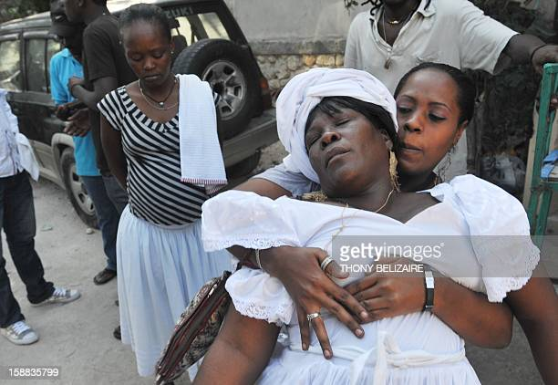Women take part in a Voodoo ceremony December 30 2012 in the Petionville suburb of PortauPrince The Haitian government declared Voodoo an official...