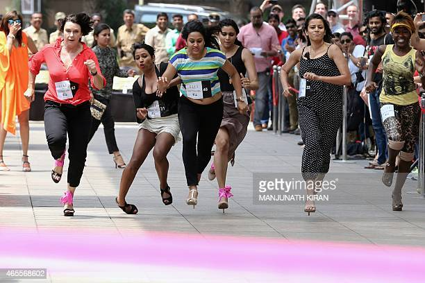 Women take part in Indias first ever 'Stilleto Run' organised by women's fashion brand Elle on International Womens Day in Bangalore on March 8 2015...