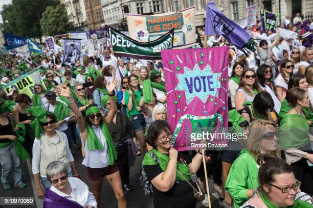 Women take part in mass participation artwork 'Processions' to celebrate one hundred years of votes for women on June 10 2018 in London England Women...