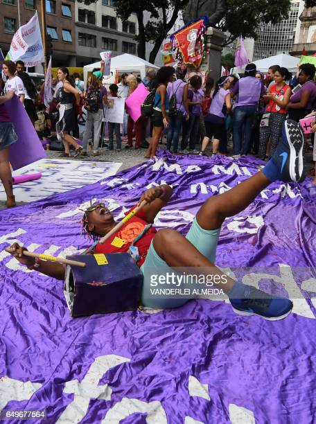 Women take part in the commemoration of the International Women's Day at Candelaria square in Rio de Janeiro Brazil on March 8 2017 The International...