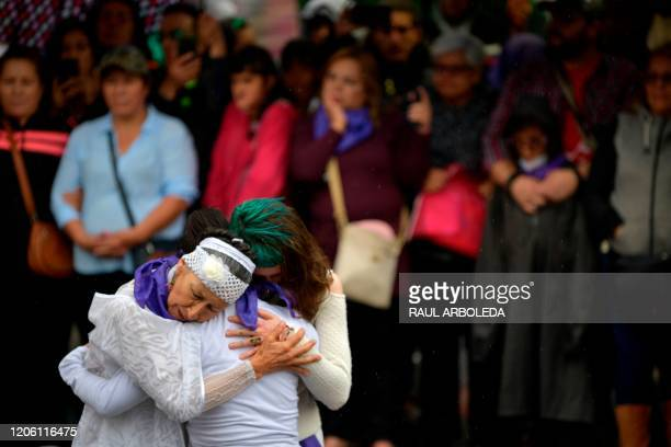Women take part on a performance during the International Women's Day demonstration in Bogota on March 8 2020 Women around the globe are taking...