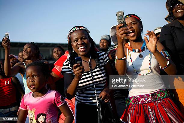 Women take pictures with their mobile phones at a concert on September 23 2006 in Soweto Johannesburg South Africa The concert was part of Soweto...