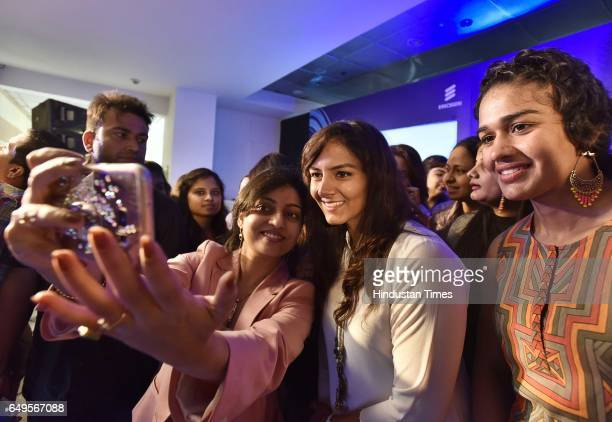 Women take selfie with Phogat Sisters Geeta and Babita on the occasion International Women's Day at a function in Ericsson Forum DLF Cybercity on...