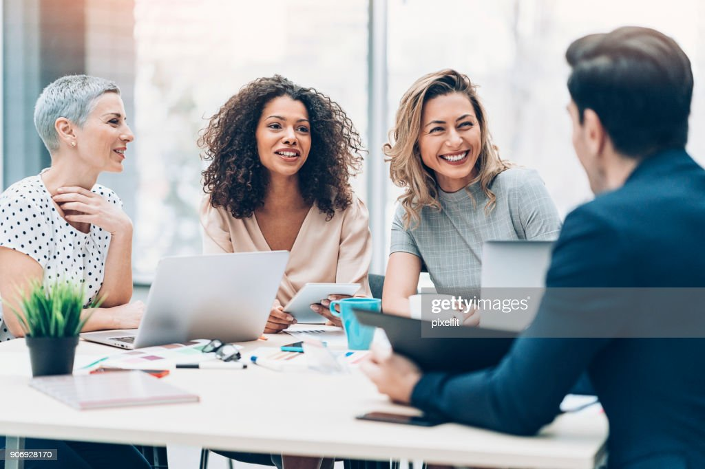 Women take the leading role in business : Stock Photo