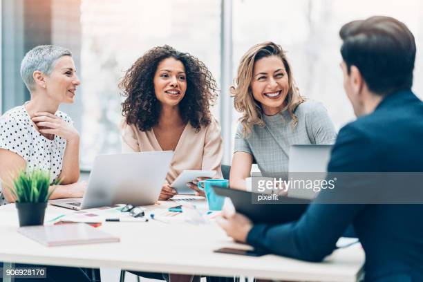 women take the leading role in business - happy stock photos and pictures