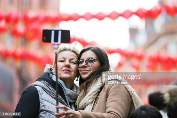 Women takes a selfie with the Chinese lanterns during the celebrations of Chinese New Year, the Year of the Rat.