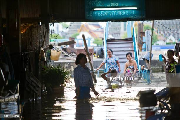 CONTENT] Women taking a bath inside a flooded market in Yai district of Bangkok Thailand on the Thonburi west bank of the Chao Phraya River Severe...
