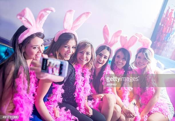 women taking a selfie at a bachelorette party - addio al nubilato foto e immagini stock
