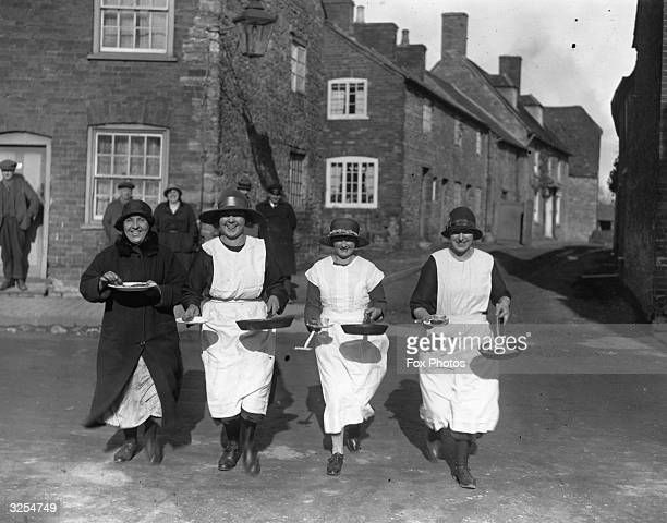 Women taking part in ancient Pancake Day customs at Olney in Buckinghamshire