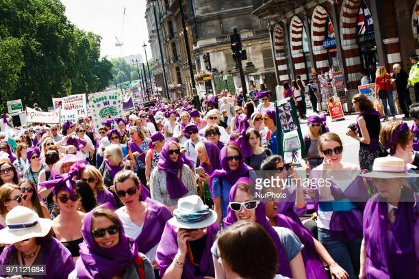 Women taking part in the UKwide 'Processions' mass art event marking a century since Britains Suffragette movement saw the first women win the right...