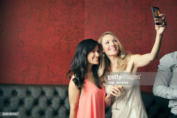Women taking picture together in nightclub