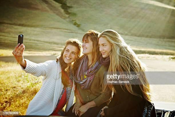 Women taking self portrait with smart phone