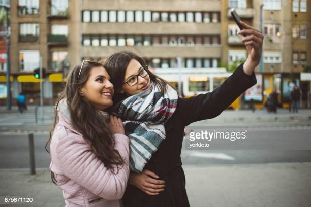women taking selfie in budapest