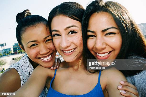 Women taking selfie on urban rooftop