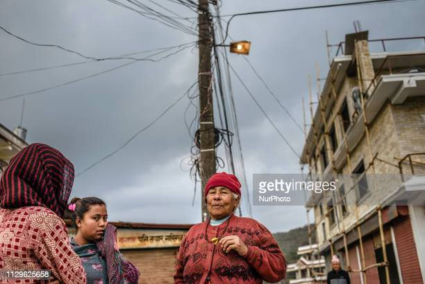 Women talk on the street of Pokhara Nepal in March 2019