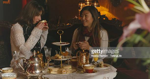 2 women talking and having high tea in melbourne - afternoon tea stock pictures, royalty-free photos & images