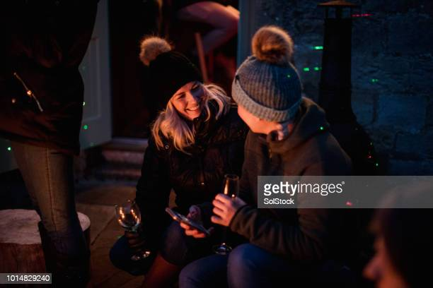 women talking by the campfire - warming up stock pictures, royalty-free photos & images