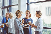 Women talking during coffee break at convention center