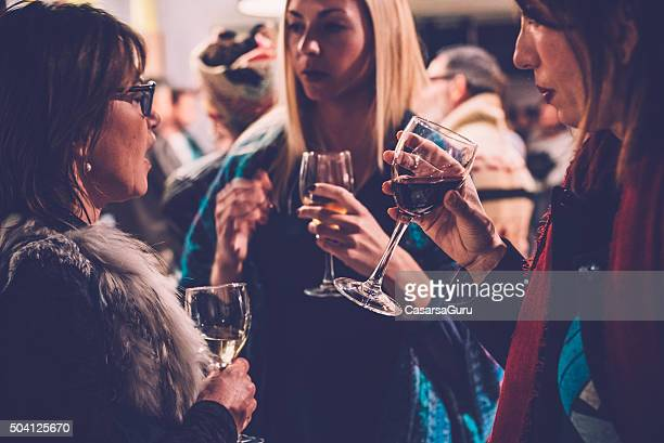 Women Talking in a Wine Bar at a Social Gathering