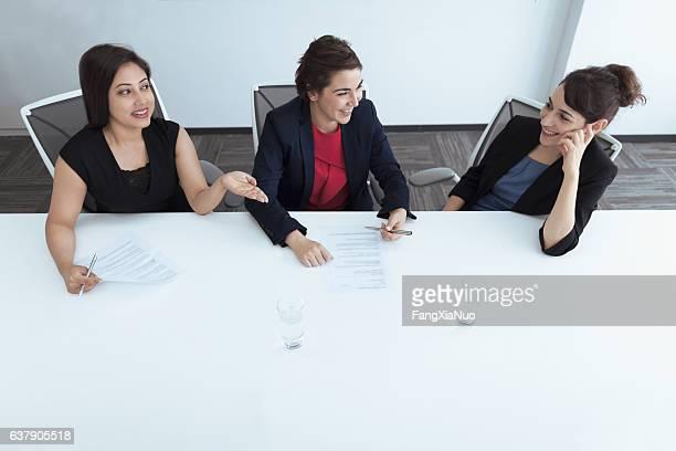 Women talking in business office meeting