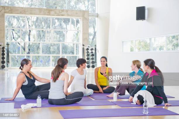 Women talking in class after exercise