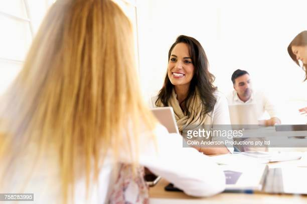 Women talking in office