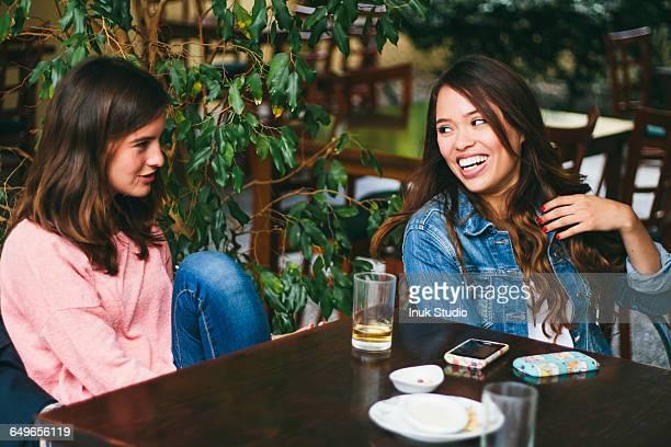 Women talking in outdoor cafe