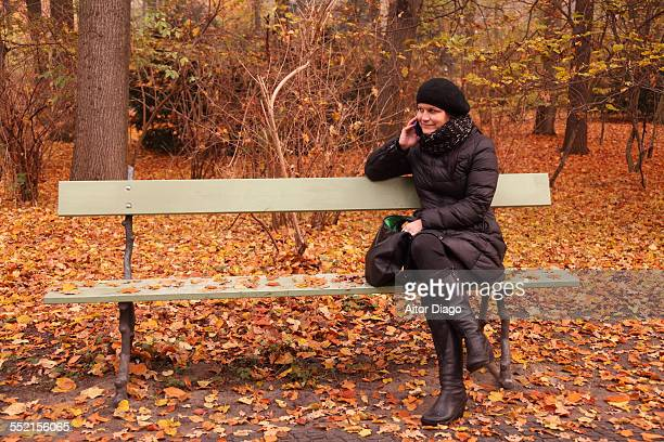 Women talking on bench in park