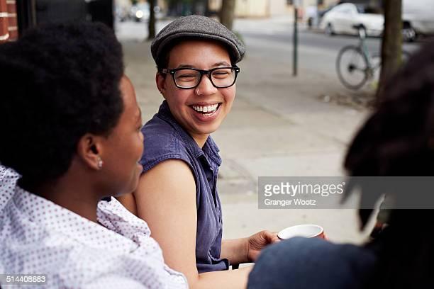Women talking on city street