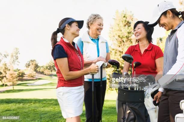 Women talking on golf course