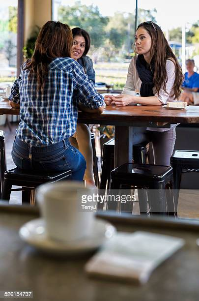 Women Talking Over a Cup of Coffee at a Restaurant