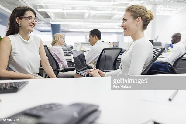 Women talking together in office