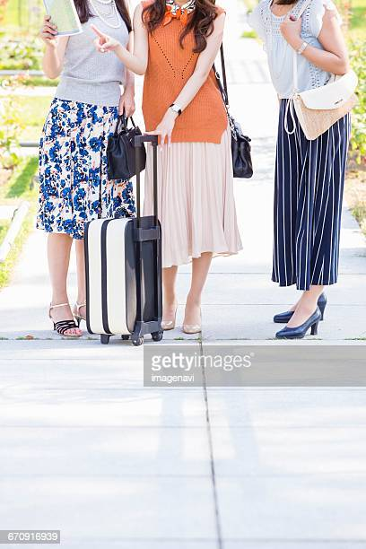 Women talking while seeing a map