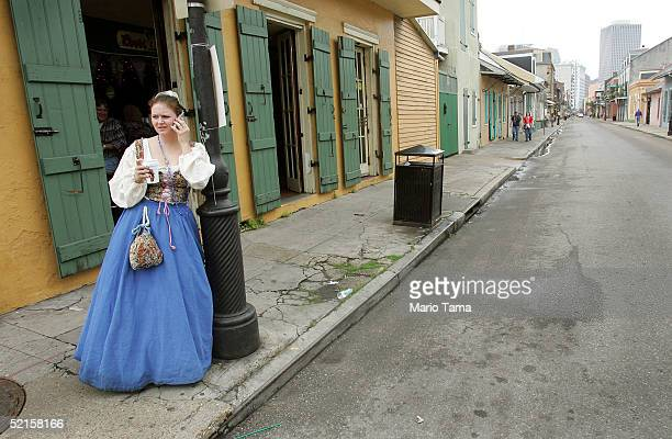 A women talks on her cell phone in the French Quarter during Mardi Gras festivities February 8 2005 in New Orleans Louisiana Mardi Gras is the last...