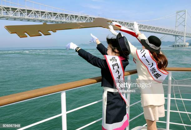 Women tasked with promoting the worldrenowned Naruto whirlpools in Tokushima Prefecture western Japan throw a ceremonial key into waters in the...