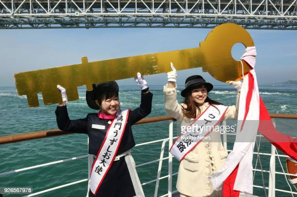Women tasked with promoting the worldrenowned Naruto whirlpools in Tokushima Prefecture western Japan hold a ceremonial key during an event marking...