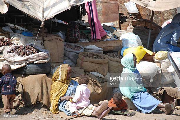 Women tend to their market stalls in the Eritrean capital Asmara on November 3, 2007. The red and blue logo of US-government food aid is a common...