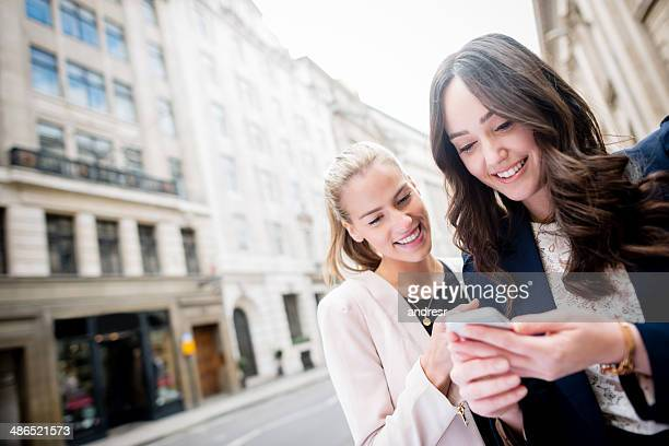 Women texting on the phone