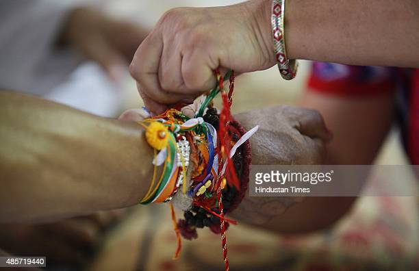 Women tied Rakhis to the exservicemen who are protesting and sitting on hunger strike against the delay in implementation of the One Rank One Pension...