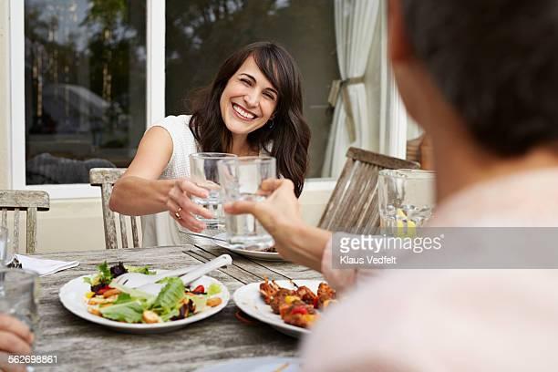 Women toasting at oustide dinner on terrace